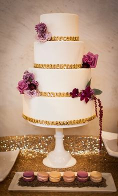 Gold Wedding Cake with rich red flowers instead of purple