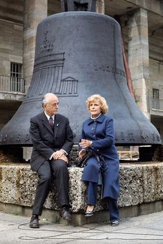 Albert Speer and Leni Riefenstahl sitting in front of the Olympic bell at the Olympic Stadium in Berlin - 1972