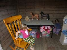 What was once the lock-up for prisoners is now a cubby house for two little girls and their dolls.