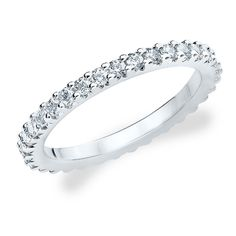 A radiant eternity band featuring diamonds set in a lustrous and superbly crafted shared prong knife edge setting. $561