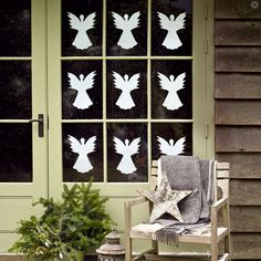 Paper-cut angels are a simple, inexpensive way to add holiday flair to your windows. Source
