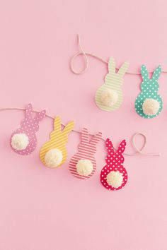 This colorful Easter garland is so easy to make with scrapbook paper and yarn! Both kids and adults will love making this Easter craft together. Get the free template on the blog!