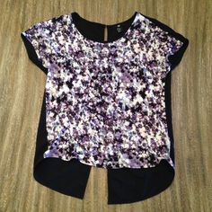 H&M shirt - size XS-M Gorgeous, floaty H&M shirt. It is size XS, but it could fit up to a size medium. The front floral material is a soft t-shirt like material. The black is a floaty fabric. It's super comfortable and fun! The back opens, so you can wear it like that or with a cami underneath. Let me know if you have questions! Make me an OFFER! I'm also potentially open to TRADES!  H&M Tops Blouses
