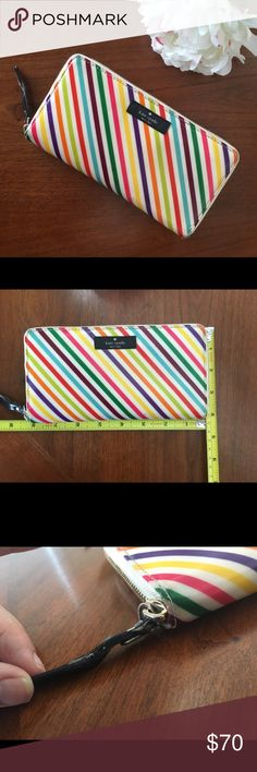 Kate spade large wallet rainbow live colorfully VGUC authentic large Kate spade accordion full zip around style wallet. Style: live colorfully daycation neda. I've used this as my main wallet for the past 5 years or so. The exterior has some minor signs of wear especially around the corners and on the zipper tag. Zoom in on photos to see more detail. The interior is in EUC. It as a ton of slots for cards and IDs, I fit my check book in it as well and even my iPhone. All zippers work great…