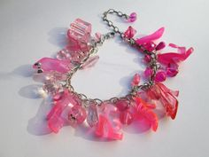This bracelet is 7 inches long .It has Translucent Pink Barbie shoes , and beads as charms.