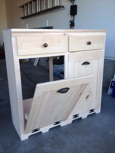 Our version of the tilt out trash/recycle can holder at A&R Woodworks.  www.facebook.com/AandRWoodworks