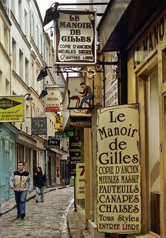 A typical passageway leading off rue du Faubourg Saint-Antoine, filled with cabinetmaker workshops. The neighborhood's furniture makers were traditional leaders of dissent before, during and after the French Revolution.