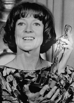 """Maggie Smith at the Academy Awards in 1979 with her Best Supporting Actress Oscar for 1978's """"California Suite""""."""