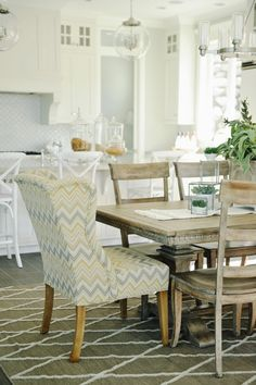 Love the wing chair at the table.