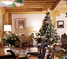 Log home living room and dining area with Christmas tree