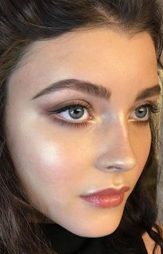 Beautiful glowy spring makeup! Try a rosy coral to bring some orange into your look. Try Siren Lipstick in