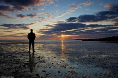 A man watches the sunrise at Whitstable, Kent. Forecasters have told holidaymakers to make. Tears Of The Sun, Art Society, Enjoy The Sunshine, Crossfire, Beach Scenes, Mind Blown, Whitstable Kent, Sunrise, Man Watches