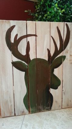 Hand painted deer head silhouette on salvaged pallet wood