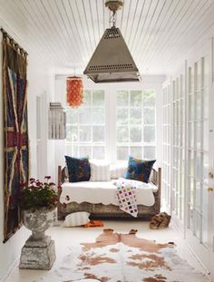 brit style sun porch: a lovely place to get lost with a good book.