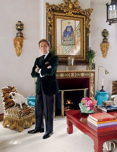 Valentino in front of a hand-painted fireplace at his house, Chateau de Wideville / PUG!