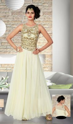 Cherish the exotic present stepping out in this butter cream shade embroidered net gown. The ethnic butta and stones work over a clothing adds a sign of splendor statement for the look. Gown Dress Online, Dresses Online, Indian Gowns Dresses, Prom Dresses, Formal Dresses, Net Gowns, New Designer Dresses, Printed Gowns, Party Gowns