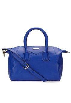Flaunt your fashionista style when you step out this season with this classic royal blue hued Boston bag from the Garden Party Collection of Heys. Available via www.namshi.com
