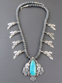 Kingman Turquoise Silver Feather Necklace by Ray Delgarito www.SouthwestSilverGallery.com