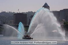 Portland Fire Boat, Rose Festival. The fire boats escort the military ships down the Willamette River and under the bridges as they arrive and depart for the Rose Festival each year.