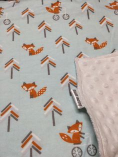A personal favorite from my Etsy shop https://www.etsy.com/listing/262285294/fox-baby-blanket-blanket-woodland