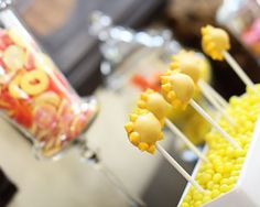 Love the fun display using lemon heads to hide the sunshine cake pop holders. Also love the peach ring candy idea :)