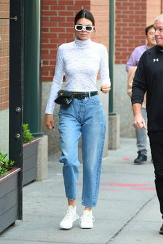 Kendall Jenner wearing Chanel Belt Bag, Illesteva Vinyl Sunglasses and Converse Chuck Taylor All Star Ii High Top Sneakers in Parchment