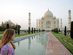 A girl gazes across the Lotus Pool toward the marble dome of the Taj Mahal. [Photo by Will Gray, Corbis]
