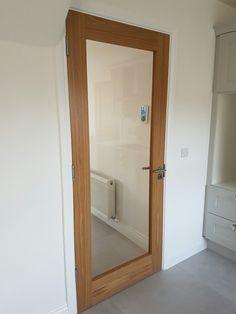Oak shaker glass doors by Murphy Larkin
