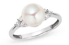 Pearl and diamond ring  Wedding gift from my husband. It completed the set: necklace and ear rings.