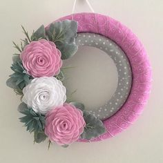 "Handmade pink felt flower ribbon wrapped wreath.  Wreath form measures 14"". #feltflowers"