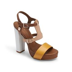 "Tommy Hilfiger women's shoe. Work day or night out, this colorblock platform sandal with stacked heel can do it all. Wide straps for comfort and flare. • Sandal with leather upper. • 4.5"" heel, padded insole, rubber outsole.• Imported."