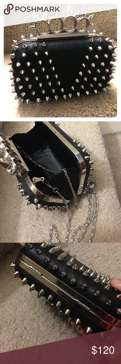 🤘Spike-studded hand clutch wallet/purse👜 Faux leather, handle grip feels comfortable and has a metal strap (hidden). Measures 6x4x2. Unique design !!! Used only once. Nordstrom Bags Mini Bags