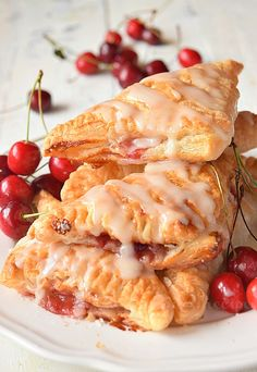Cherry turnovers made with puff pastry- makes them so amazing,with vanilla glaze! You wont believe these cherry turnovers are store bought or homemade Gourmet Recipes, Dinner Recipes, Healthy Recipes, Bread Recipes, Healthy Desserts, Easy Desserts, Easy Recipes, Vegetarian Recipes, Homemade Cherry Pies