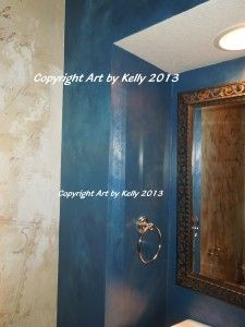 A close up look at the blue venetian plaster troweled on the niche around the pedestal sink.