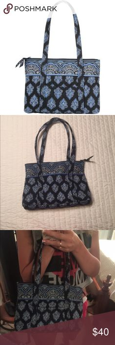 Authentic Vera Bradley Little Betsy Purse New with tags, never been used, Authentic Retired Vera Bradley Purse. Can't find anywhere else! This bag is a vintage collectors. Bag is in fantastic, brand new shape. Color is different shades of blue and pattern is classic and versatile. One pocket on the outside, six on the inside. Please let me know if you would like more info/photos. OPEN TO OFFERS!!! Vera Bradley Bags Shoulder Bags