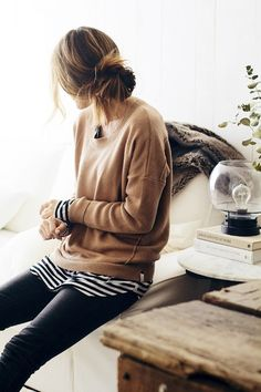 messy low bun, camel sweater, striped tee and black jeans // spring layers