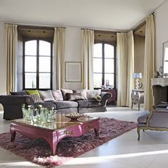 Floor to ceiling drapes make any room more dramatic.