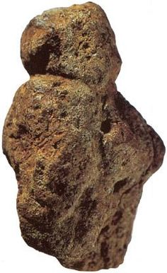 The female figurine from Berekhat Ram, in Israel. It is the oldest known figurative carving in the world, and is somewhere between 233 000 and 800 000 years old, older than Neanderthal man. The date is between these values because it has been found between two layers of volcanics, the upper one is about 230,000 years old, and the lower one approximates 800,000 years old
