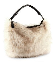 Fake fur bag with an imitation leather handle with rivets. Zip at the top  and three inner pockets 1261669da37de