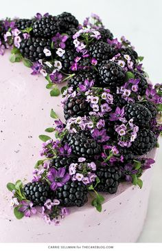 Blackberry Lime Cake - tender cake infused with lime zest, frosted with blackberry buttercream, topped withfresh blackberries and edible flowers | by Carrie Sellman for TheCakeBlog.com