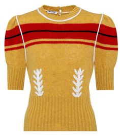 Miu Miu - Striped virgin wool sweater - Opt for a vintage feminine look with this pullover by Miu Miu. Channeling the '70s, the striped intarsia on a mustard yellow hue is complemented by a vine pattern and piping along the seams. The puffed shoulders add a touch of volume to the fitted silhouette. Pair yours with a midi skirt to embody the girlish ethos of the brand. seen @ www.mytheresa.com