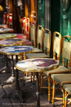 Cafe tables and chairs waiting for customers in Place du Tertre, Montmartre, Paris France. © Brian Jannsen Photography