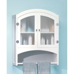 "Understated cabinet elegantly hides bath products and towels behind opaque glass doors. Silver-finished, magnetic-latch hardware. Dimensions 24.2"" x 37"" x 30.5"""
