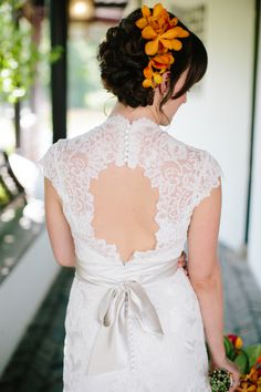 Good close up of back of dress and flowers in hair Photography: Angela Newton Roy - angelanewtonroy.com  Read More: http://www.stylemepretty.com/tri-state-weddings/2014/04/11/colorful-botanic-garden-wedding/