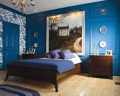 Dormitorio en azul y marrón