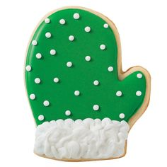 Adorned with holiday green, these cookies are a treat to make! Mitten shapes are cut with the Comfort Grip Cutter. Add icing designs with color flow icing!