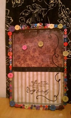A take on the cookie sheet magnet board! Cute way to use a cookie sheet. Can use as picture frame.