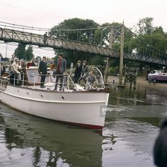 STUDIOS Photo of BEATLES and Ringo STARR and Paul McCARTNEY and John LENNON and George HARRISON, The Beatles arriving at Teddington Studios for Thank Your Lucky Stars on a river boat - L-R Ringo Starr, Paul McCartney, John Lennon and George Harrison