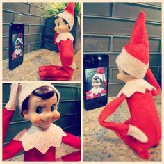 Elf on shelf taking selfies!