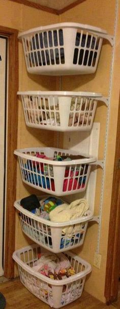 I am in love with this. I mean this way the kids could just run up and grab their hamper and take it to their room and put the clothes up and then bring it downstairs. each basket could even be monogramed                                                                                                                                                      More